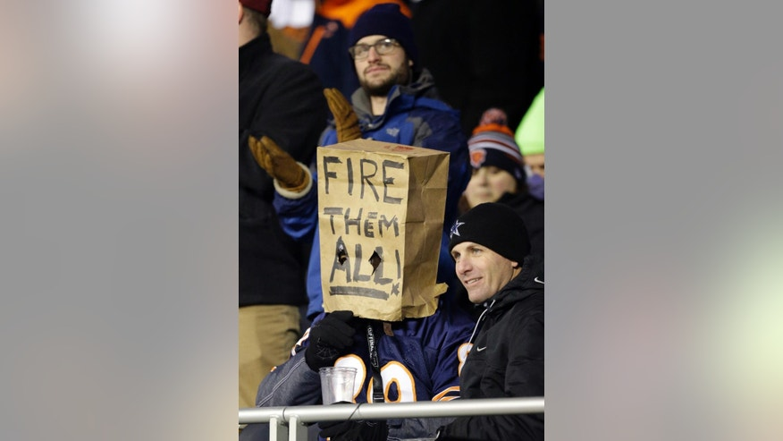 A Chicago Bears fan wears a paper bag during the second half of an NFL football game against the Dallas Cowboys Thursday, Dec. 4, 2014, in Chicago. (AP Photo/Nam Y. Huh)