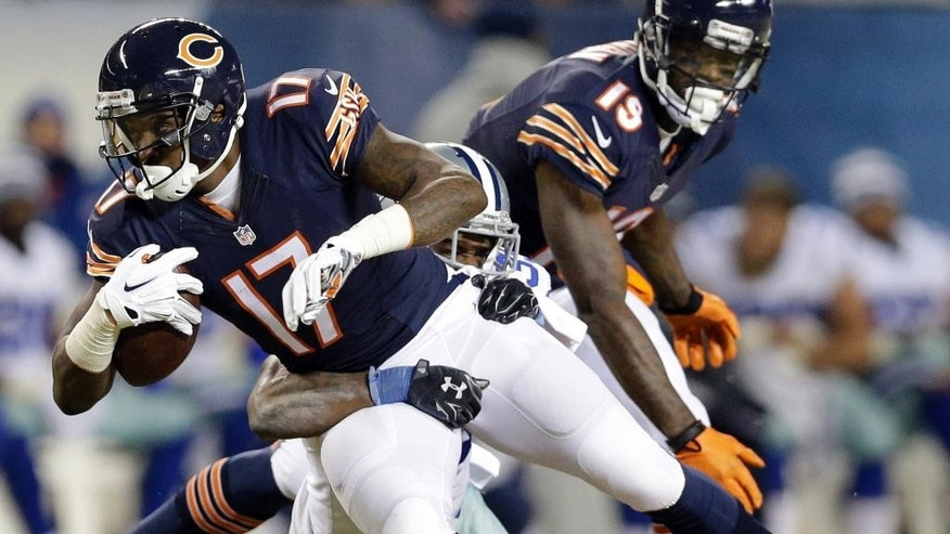 Dallas Cowboys cornerback Brandon Carr (39) tackles Chicago Bears wide receiver Alshon Jeffery (17) during the first half of an NFL football game Thursday, Dec. 4, 2014, in Chicago. (AP Photo/Nam Y. Huh)