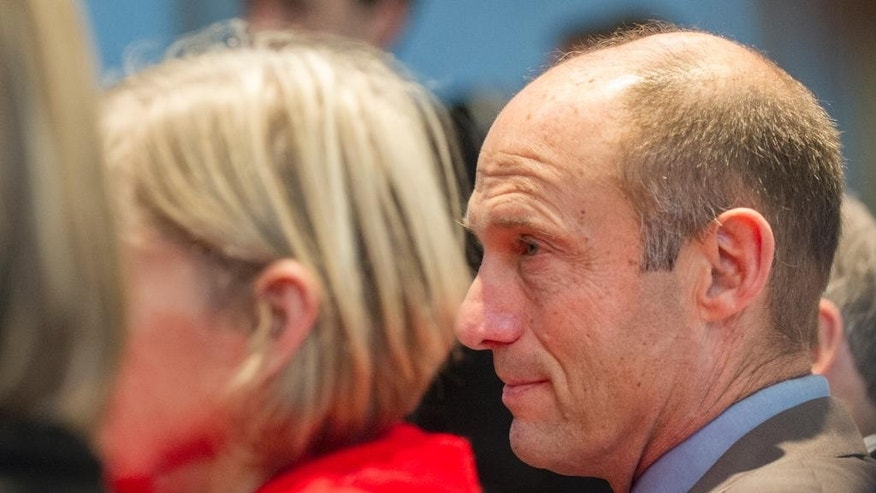 Nebraska's new football coach Mike Riley sits with his wife Dee, left, as he is introduced at an NCAA college football news conference at Memorial Stadium on Friday, Dec. 5, 2014 in Lincoln, Neb.  Riley, who came from Oregon State, replaces Bo Pelini who was fired last Sunday. (AP Photo/The Journal-Star, Eric Gregory) LOCAL TELEVISION OUT; KOLN-TV OUT; KGIN-TV OUT; KLKN-TV OUT