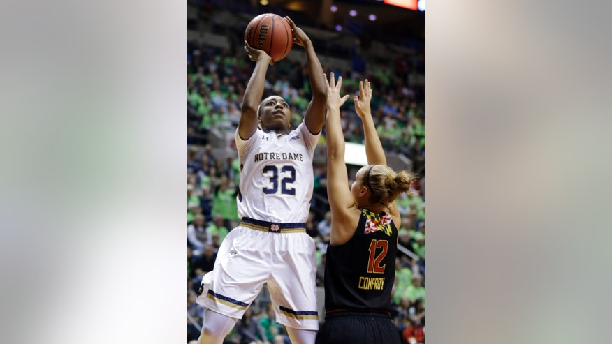 Notre Dame guard Jewell Loyd, left, shoots over Maryland guard Kristen Confroy in the first half of an NCAA college basketball game in Fort Wayne, Ind., Wednesday, Dec. 3, 2014. (AP Photo/Michael Conroy)