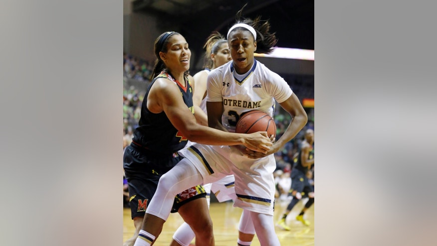 Maryland center Brionna Jones, left, tries to tie up Notre Dame guard Jewell Loyd  in the second half of a women's NCAA college basketball game in Fort Wayne, Ind., Wednesday, Dec. 3, 2014.  (AP Photo/Michael Conroy)