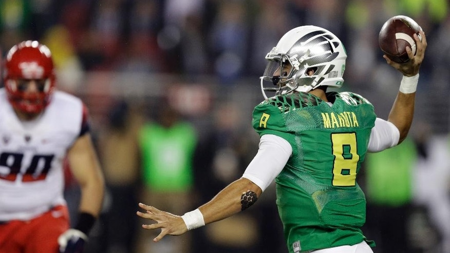 Oregon's Marcus Mariota, right, passes against Arizona during the first half of a Pac-12 Conference championship NCAA college football game Friday, Dec. 5, 2014, in Santa Clara, Calif. (AP Photo/Ben Margot)