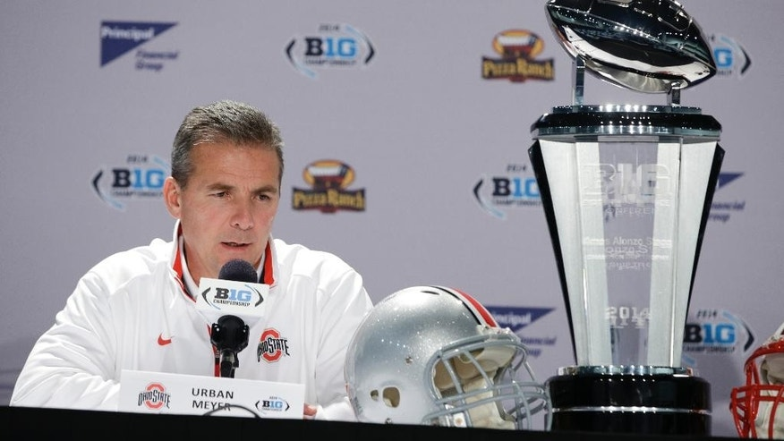 Ohio State head coach Urban Meyer responds to a question during a news conference for the Big Ten Conference championship NCAA college football game Friday, Dec. 5, 2014, in Indianapolis. Ohio State will play Wisconsin,  Saturday for the championship. (AP Photo/Darron Cummings)