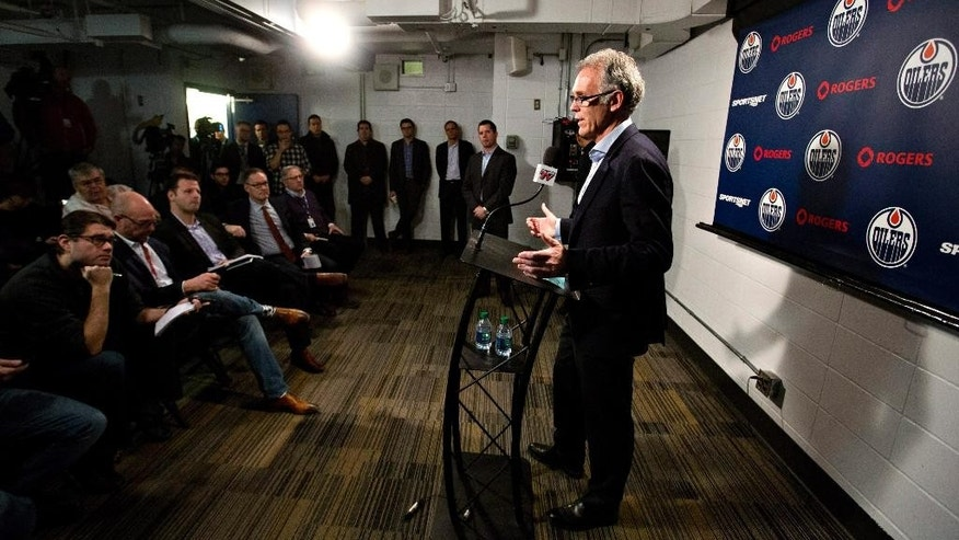 Edmonton Oilers general manager Craig MacTavish speaks about the state of the NHL hockey club's 11 game losing streak during a press conference in Edmonton, Alberta, Friday, Dec. 5, 2014. (AP Photo/The Canadian Press, Jason Franson)