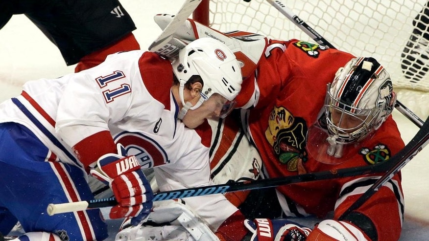 Chicago Blackhawks goalie Antti Raanta (31) saves a shot by Montreal Canadiens right wing Brendan Gallagher (11) during the third period of an NHL hockey game in Chicago, Friday, Dec. 5, 2014. The Blackhawks won 4-3. (AP Photo/Nam Y. Huh)
