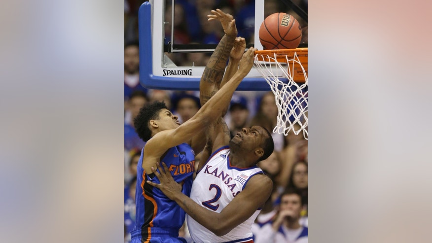 Florida forward Devin Robinson (3) shoots over Kansas forward Cliff Alexander (2) during the first half of an NCAA college basketball game in Lawrence, Kan., Friday, Dec. 5, 2014. (AP Photo/Orlin Wagner)