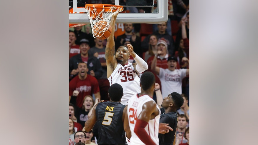 Oklahoma forward TaShawn Thomas (35) dunks in front of Missouri forward D'Angelo Allen (5) and Missouri guard Namon Wright, right, in the first half of an NCAA college basketball game in Norman, Okla., Friday, Dec. 5, 2014. (AP Photo/Sue Ogrocki)
