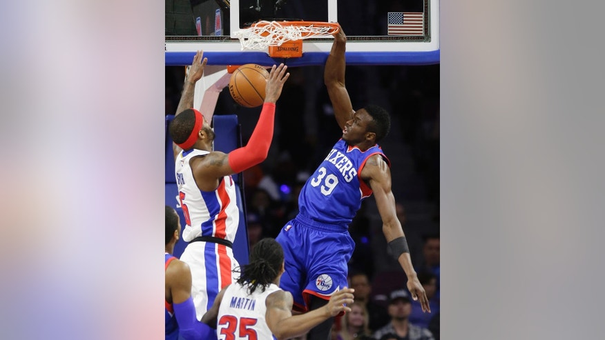 Philadelphia 76ers forward Jerami Grant (39) dunks against Detroit Pistons forward Josh Smith (6) during the first half of an NBA basketball game in Auburn Hills, Mich., Saturday, Dec. 6, 2014. (AP Photo/Carlos Osorio)
