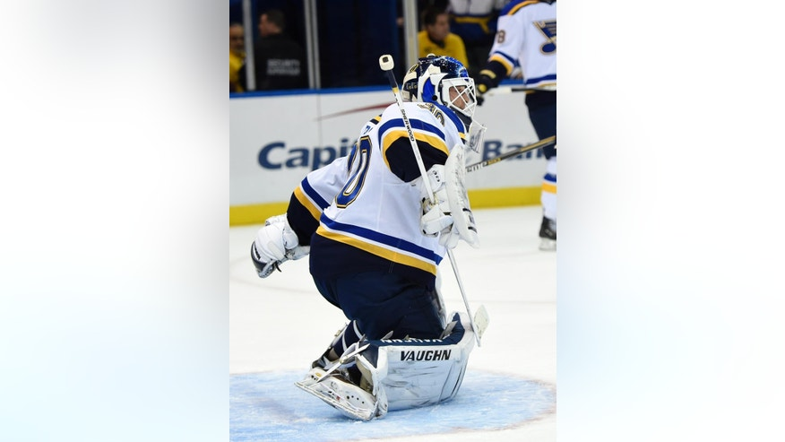 St. Louis Blues new goalie Martin Brodeur (30) blocks shots on goal during practice before an NHL hockey game against the New York Islanders at Nassau Coliseum on Saturday, Dec. 6, 2014, in Uniondale, N.Y. (AP Photo/Kathy Kmonicek)