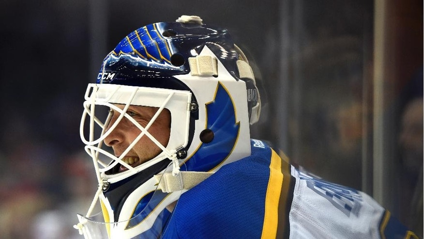 St. Louis Blues new goalie Martin Brodeur (30) waits his turn for practice in the goal before an NHL hockey game against the New York Islanders at Nassau Coliseum on Saturday, Dec. 6, 2014, in Uniondale, N.Y. (AP Photo/Kathy Kmonicek)