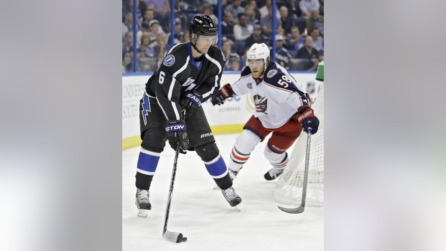 Tampa Bay Lightning defenseman Anton Stralman (6), of Sweden, carries the puck around Columbus Blue Jackets defenseman David Savard (58) during the second period of an NHL hockey game Saturday, Dec. 6, 2014, in Tampa, Fla. (AP Photo/Chris O'Meara)