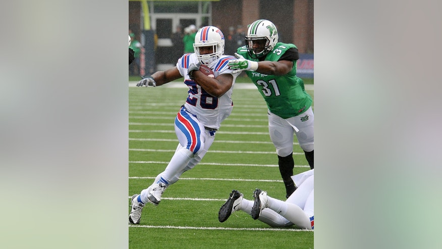 Louisiana Tech's Kenneth Dixon (28) runs the ball against Marshall during the Conference USA championship NCAA college football game in Huntington, W.Va., Saturday Dec. 6, 2014. (AP Photo/Chris Tilley)