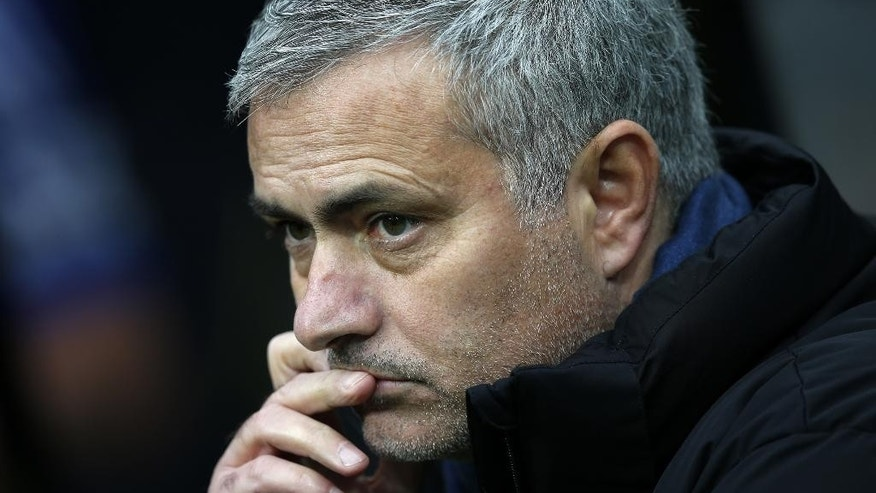 Chelsea manager Jose Mourinho looks on ahead of their English Premier League soccer match against Newcastle United at St James' Park, Newcastle, England, Saturday, Dec. 6, 2014. (AP Photo/Scott Heppell)