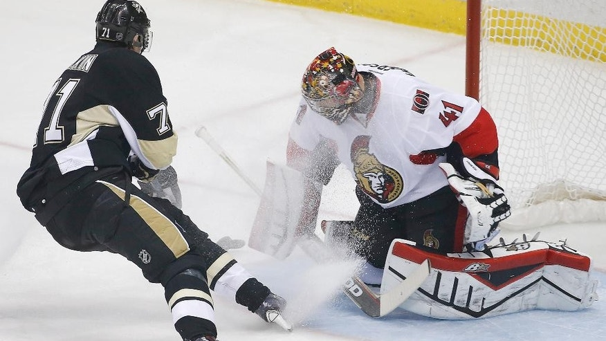 Pittsburgh Penguins' Evgeni Malkin (71) scores a goal past Ottawa Senators goalie Craig Anderson (41) during the first period of an NHL hockey game in Pittsburgh Saturday, Dec. 6, 2014.(AP Photo/Gene J. Puskar