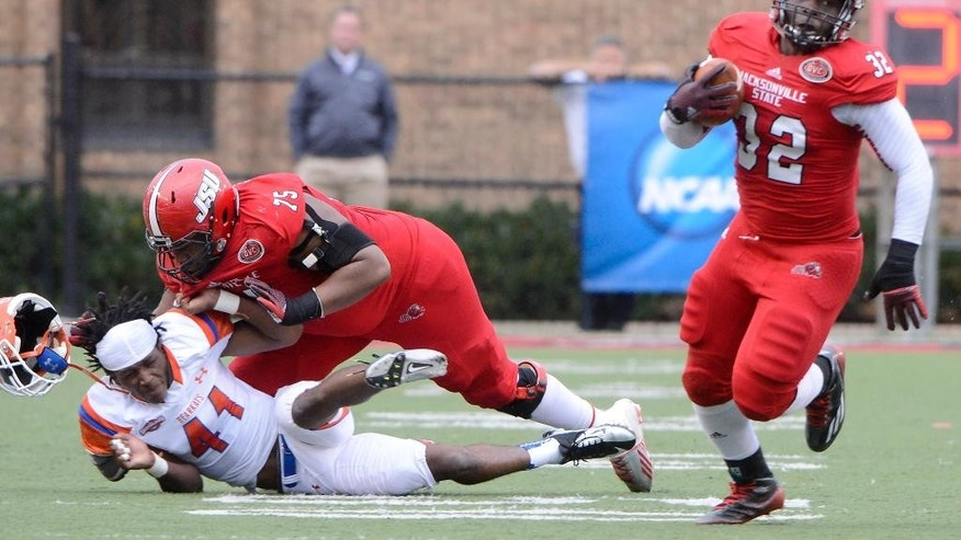 Jacksonville State running back DaMarcus James breaks loose as Jacksonville State offensive lineman Kyron Samuels blocks Sam Houston State safety Tyrel Stokes (41) in the second quarter of an NCAA FCS college football second-round playoff game in Jacksonville, Ala., Saturday, Dec. 6, 2014. (AP Photo/AL.com, Mark Almond) MAGAZINES OUT