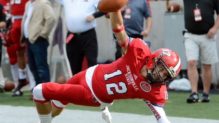 Jacksonville State wide receiver Josh Barge falls at the 1-yard line in the first quarter against Sam Houston State in an NCAA FCS college football second-round playoff game in Jacksonville, Ala., Saturday, Dec. 6, 2014. (AP Photo/AL.com, Mark Almond) MAGAZINES OUT
