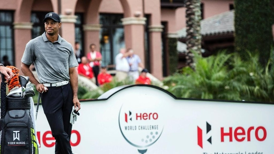 Tiger Woods waits to tee off on the first hole during the second round of the Hero World Challenge golf tournament on Friday, Dec. 5, 2014, in Windermere, Fla. (AP Photo/Willie J. Allen Jr.)