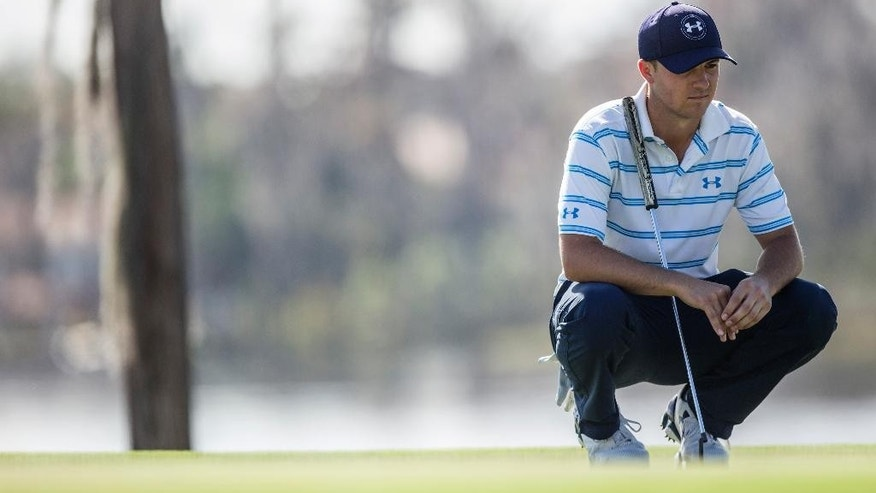 Jordan Spieth waits for his turn to putt on the second hole during the third round of the Hero World Challenge golf tournament on Saturday, Dec. 6, 2014, in Windermere, Fla. (AP Photo/Willie J. Allen Jr.)