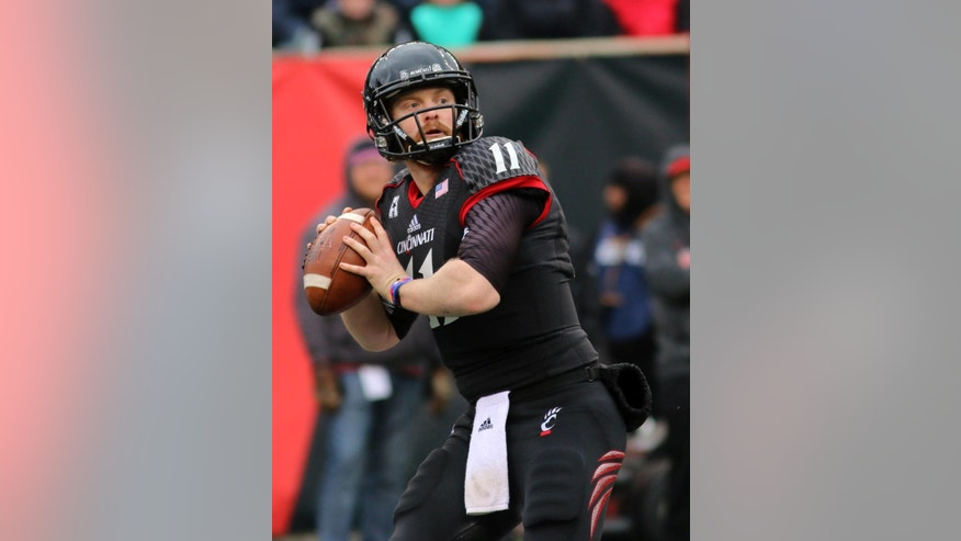 Cincinnati's quarterback Gunner Kiel passes against Houston during the first half of an NCAA college football game Saturday Dec. 6, 2014, in Cincinnati. (AP Photo/Tom Uhlman)