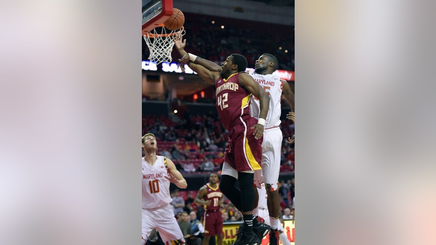 Winthrop forward Josh Davenport (42) goes to the basket against Maryland forward Jon Graham, right, during the first half of an NCAA college basketball game, Saturday, Dec. 6, 2014, in College Park, Md. (AP Photo/Nick Wass)