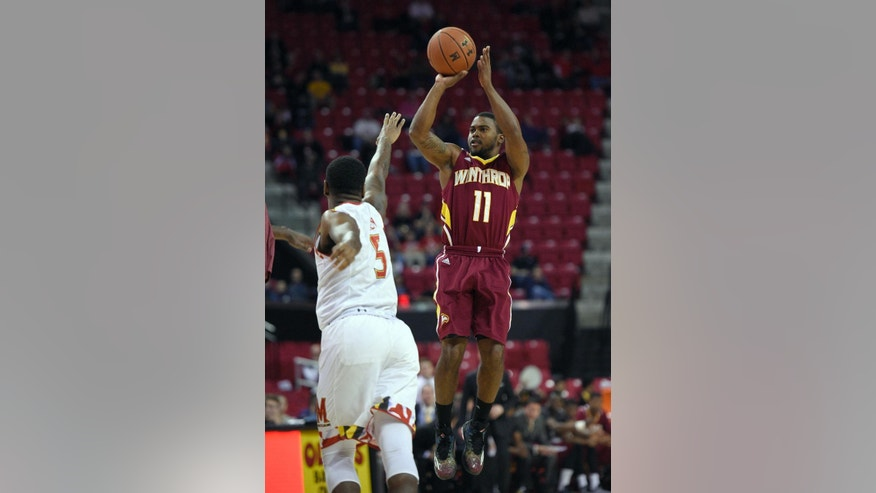 Winthrop guard Andre Smith (11) takes a shot against Maryland guard Dion Wiley (5) during the first half of an NCAA college basketball game, Saturday, Dec. 6, 2014, in College Park, Md. (AP Photo/Nick Wass)