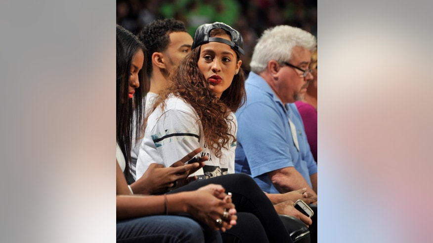 Former Notre Dame player Skylar Diggins watches the first half of an NCAA college basketball game with Connecticut, Saturday Dec. 6, 2014, in South Bend, Ind. (AP Photo/Joe Raymond)