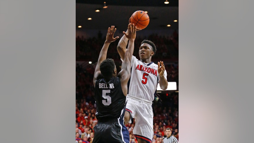 Arizona forward Stanley Johnson (5) shoots over Gonzaga guard Gary Bell Jr. (5) during the first half of an NCAA college basketball game Saturday, Dec. 6, 2014, in Tucson, Ariz. (AP Photo/The Arizona Republic, David Kadlubowski)
