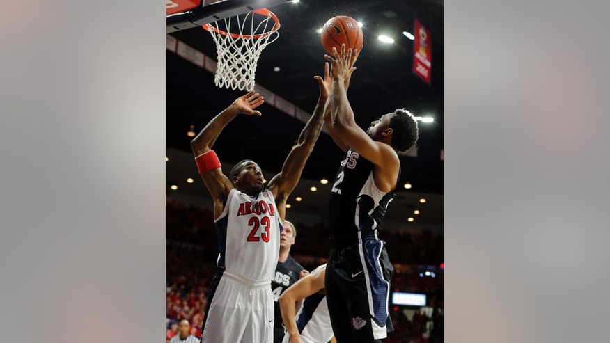 Gonzaga guard Byron Wesley (22) shoots on Arizona forward Rondae Hollis-Jefferson (23) during the first half of an NCAA college basketball game, Saturday, Dec. 6, 2014, in Tucson, Ariz. (AP Photo/Rick Scuteri)