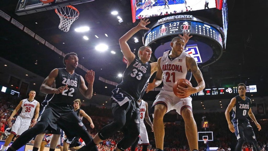 Arizona forward Brandon Ashley (21) tries to get past Gonzaga forward Kyle Wiltjer (33) during the first half of an NCAA college basketball game Saturday, Dec. 6, 2014, in Tucson, Ariz. (AP Photo/The Arizona Republic, David Kadlubowski)