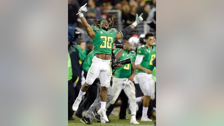 Oregon's Ayele Forde (30) celebrates after the 51-13 defeat of Arizona to win the Pac-12 Conference championship NCAA college football game Friday, Dec. 5, 2014, in Santa Clara, Calif. (AP Photo/Ben Margot)