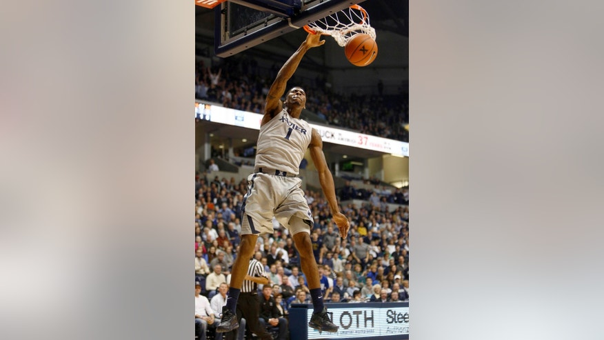 Xavier forward Jalen Reynolds dunks the ball against Alabama in the first half of an NCAA college basketball game, Saturday, Dec. 6, 2014, in Cincinnati. (AP Photo/David Kohl)