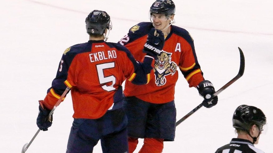 Florida Panthers left wing Tomas Kopecky celebrates his goal against the Buffalo Sabres with teammate Aaron Ekblad during the second period of an NHL hockey game, Saturday, Dec. 6, 2014, in Sunrise, Fla. (AP Photo/Joe Skipper)