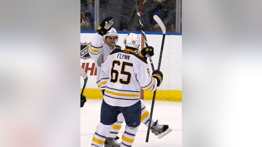 Buffalo Sabres right wing Brian Gionta (12) celebrates his score with teammate Brian Flynn (65) against the Florida Panthers during the second period of an NHL hockey game, Saturday, Dec. 6, 2014, in Sunrise, Fla. (AP Photo/Joe Skipper)