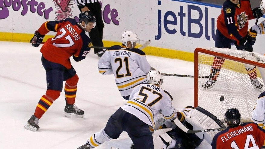 Florida Panthers center Nick Bjugstad (27) scores a goal past Buffalo Sabres right wing Drew Stafford during the second period of an NHL hockey game, Saturday, Dec. 6, 2014, in Sunrise, Fla. (AP Photo/Joe Skipper)