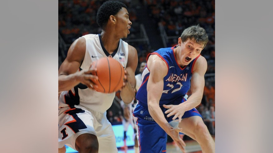 Illinois' guard Malcolm Hill (21) keeps the ball away from American's guard John Schoof (22) during an NCAA college basketball game in Champaign, Ill., Saturday, Dec. 6, 2014. (AP Photo/Robin Scholz)