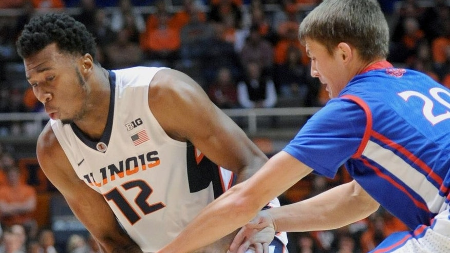 Illinois forward Leron Black (12) tries to keep the ball away from American guard Charlie Jones (20) during an NCAA college basketball game in Champaign, Ill., Saturday, Dec. 6, 2014. (AP Photo/Robin Scholz)