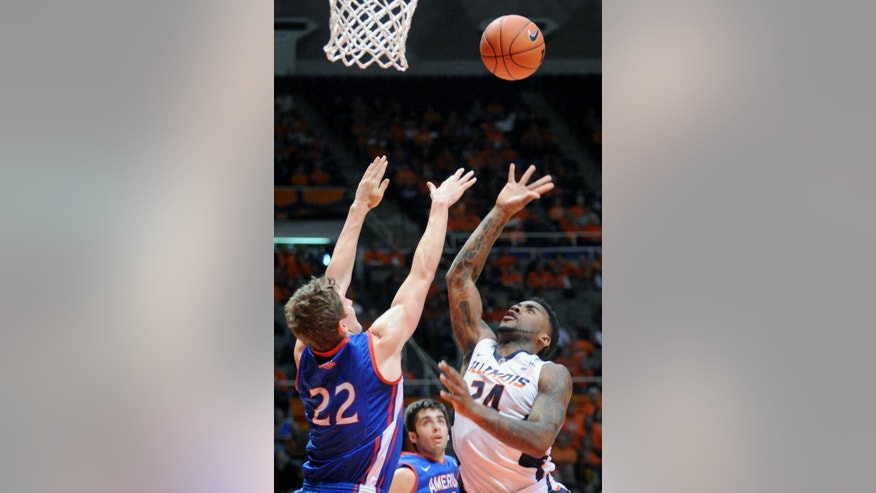 Illinois guard Rayvonte Rice (24) shoots over American guard John Schoof (22) during an NCAA college basketball game in Champaign, Ill., Saturday, Dec. 6, 2014. (AP Photo/Robin Scholz)