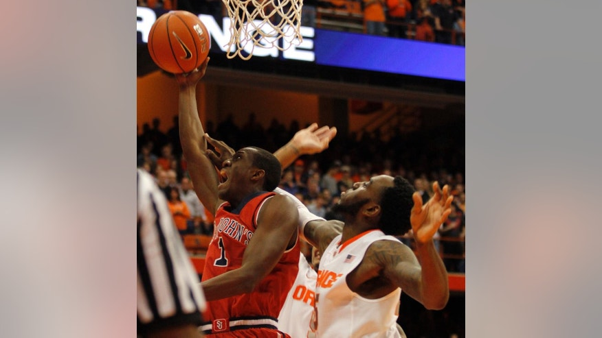 St. John's Phil Greene IV, left, grabs a rebound over Syracuse's Rakeem Christmas, right, in the first half of an NCAA college basketball game in Syracuse, N.Y., Saturday, Dec. 6, 2014. (AP Photo/Nick Lisi)