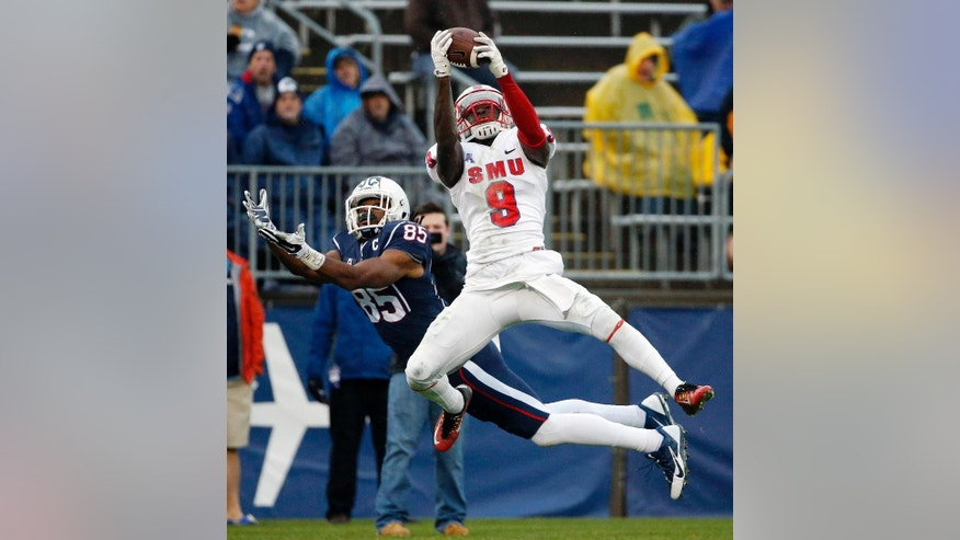 SMU defensive back Horace Richardson (9) intercepts the pass intended for Connecticut wide receiver Geremy Davis (85) during the second quarter of an NCAA college football game in East Hartford, Conn., Saturday, Dec. 6, 2014. (AP Photo/Michael Dwyer)