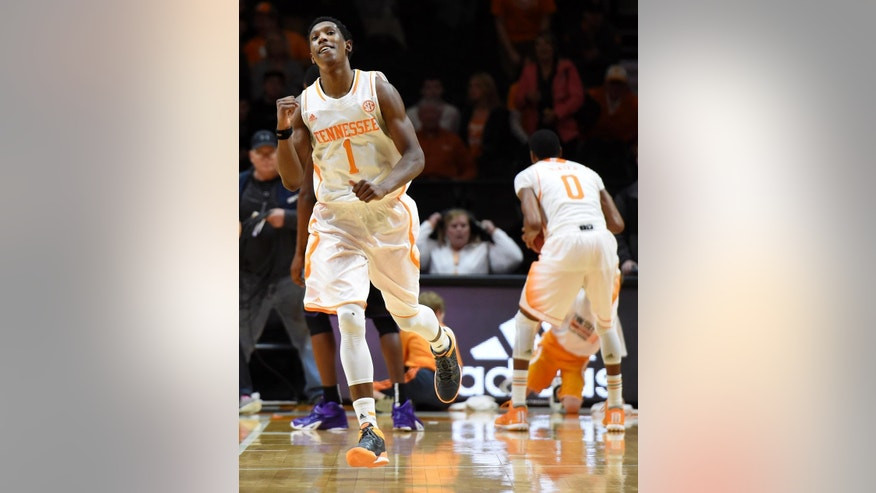 Tennessee guard Josh Richardson (1) smiles after Tennessee beat Kansas State 65-64 in an NCAA college basketball game at Thompson-Boling Arena in Knoxville, Tenn., Saturday, Dec. 6, 2014.  (AP Photo/Knoxville News Sentinel, Kevin Martin)