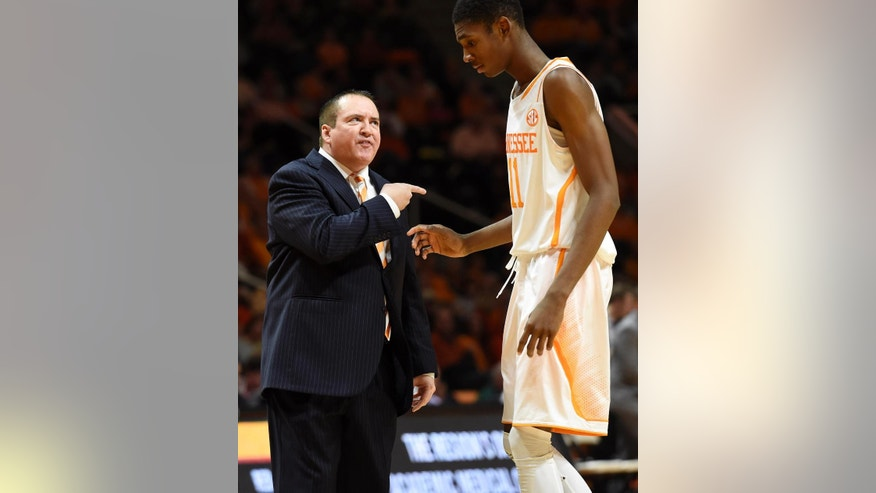 Tennessee coach Donnie Tyndall gestures to forward Tariq Owens (11) during their NCAA college basketball game against Kansas State at Thompson-Boling Arena in Knoxville, Tenn., Saturday, Dec. 6, 2014.  Tennessee won 65-64.  (AP Photo/Knoxville News Sentinel, Kevin Martin)