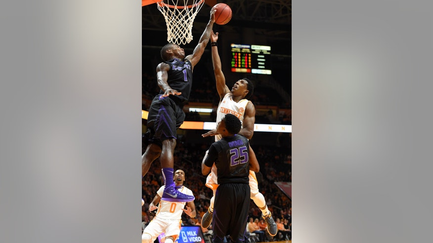 Kansas State guard Jevon Thomas (1) blocks a shot by Tennessee guard Josh Richardson (1) during an NCAA college basketball game at Thompson-Boling Arena in Knoxville, Tenn., Saturday, Dec. 6, 2014.  Tennessee won 65-64.  (AP Photo/Knoxville News Sentinel, Kevin Martin)