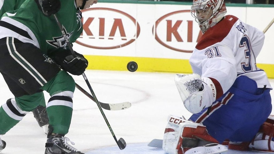 Dallas Stars center Cody Eakin (20) scores a goal against Montreal Canadiens goalie Carey Price (31) during the first period of an NHL hockey game Saturday, Dec. 6, 2014, in Dallas. (AP Photo/LM Otero)