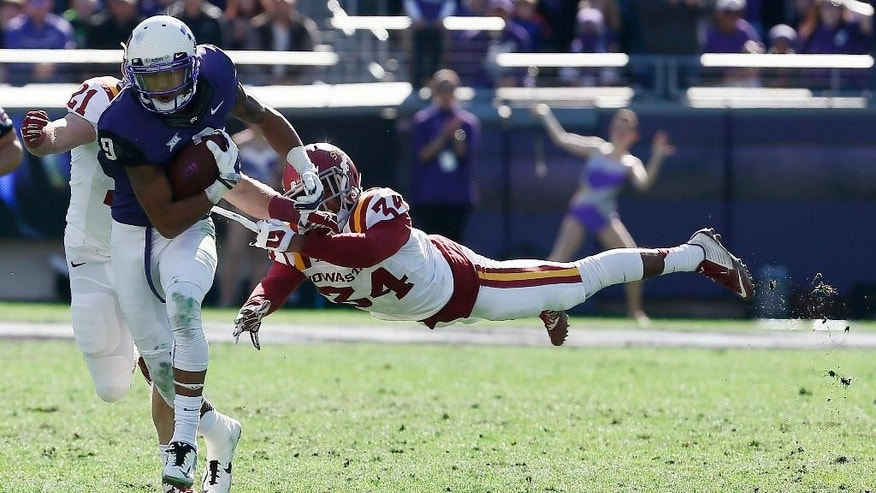 TCU wide receiver Josh Doctson (9) breaks a tackle by Iowa State defensive back Nigel Tribune (34) during the first half of an NCAA college football game at Amon G. Carter Stadium, Saturday, Dec. 6, 2014, in Fort Worth, Texas. (AP Photo/Brandon Wade)