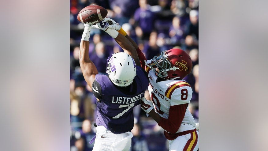 TCU wide receiver Kolby Listenbee (7) is unable to catch a pass as Iowa State defensive back Kenneth Lynn (8) defends during the first half of an NCAA college football game at Amon G. Carter Stadium, Saturday, Dec. 6, 2014, in Fort Worth, Texas. (AP Photo/Brandon Wade)