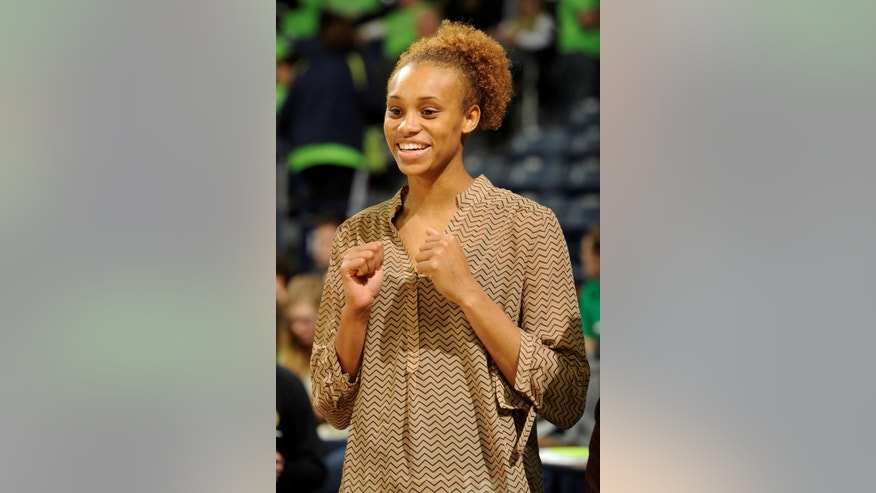 Notre Dame forward Brianna Turner stands in street clothes before an NCAA college basketball game against Connecticut, Saturday Dec. 6, 2014, in South Bend, Ind. (AP Photo/Joe Raymond)