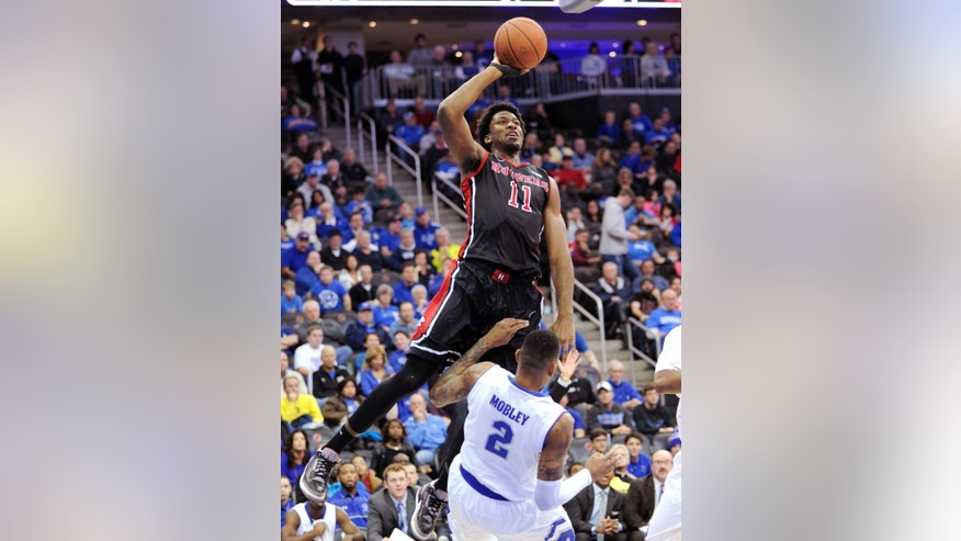 Rutgers center Kadeem Jack (11) runs into Seton Hall forward Brandon Mobley as he goes up with a shot during the first half of an NCAA college basketball game, Saturday, Dec. 6, 2014, in Newark, N.J. (AP Photo/Bill Kostroun)