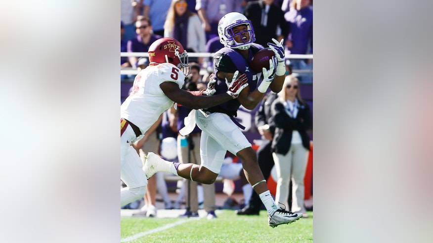 TCU wide receiver Kolby Listenbee (7) catches a pass as Iowa State defensive back Kamari Cotton-Moya (5) defends during the first half of an NCAA college football game at Amon G. Carter Stadium, Saturday, Dec. 6, 2014, in Fort Worth, Texas. (AP Photo/Brandon Wade)