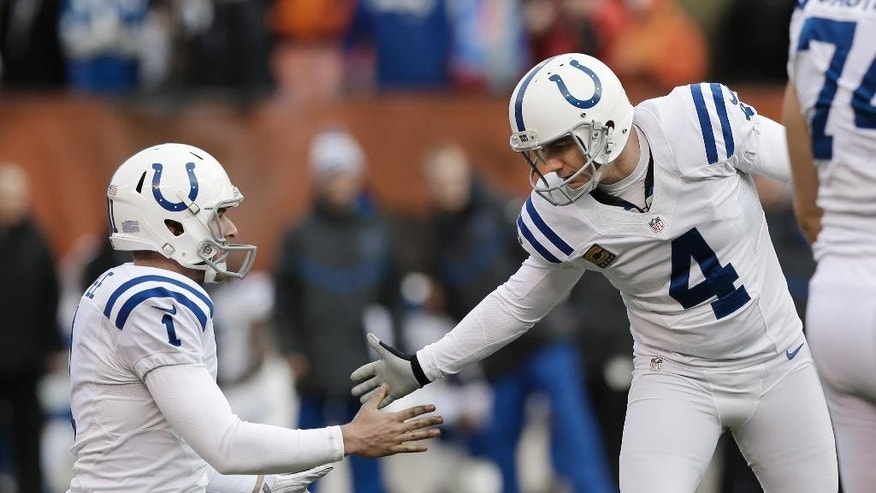 Indianapolis Colts kicker Adam Vinatieri (4) shakes hands with holder Pat McAfee (1) after a 33-yard field goal against the Cleveland Browns in the fourth quarter of an NFL football game Sunday, Dec. 7, 2014, in Cleveland. (AP Photo/Tony Dejak)