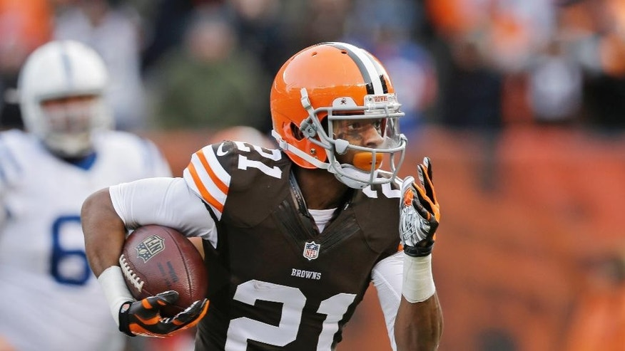 Cleveland Browns cornerback Justin Gilbert returns an interception for a touchdown against the Indianapolis Colts in the third quarter of an NFL football game Sunday, Dec. 7, 2014, in Cleveland. (AP Photo/Tony Dejak)